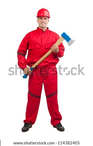 Young smiling fireman with hard hat and in full uniform holding huge ax isolated on white. - stock photo