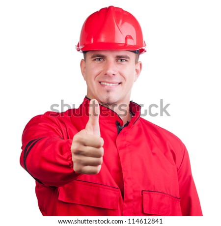 Young smiling fireman with hard hat and in full uniform showing thumbs up isolated on white. - stock photo