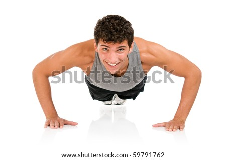 Young smiling fitness man doing push ups on floor, studio shot isolated on white background - stock photo