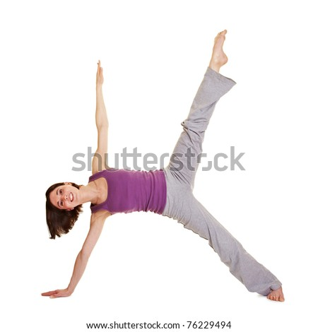 Young smiling flexible woman stretching her legs - stock photo