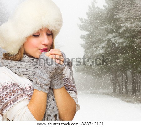 Young smiling girl at snowy forest - stock photo