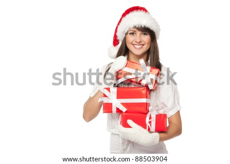 Young smiling girl in Santa hat holding a heap of gift boxes isolated with copy-space over white background - stock photo