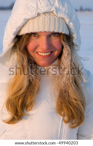 Young smiling girl in the rime - stock photo