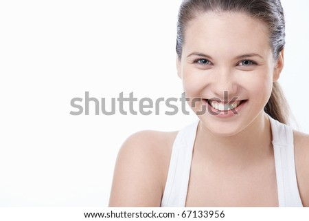 Young smiling girl on white background - stock photo
