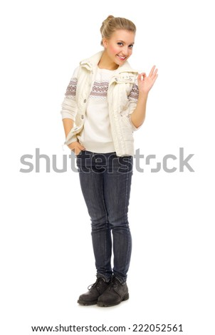 Young smiling girl shows ok gesture isolated - stock photo