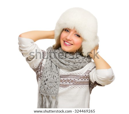 Young smiling girl with fur hat isolated - stock photo