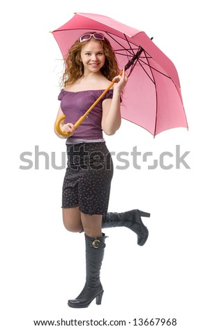 young smiling girl with pink umbrella in hands - stock photo