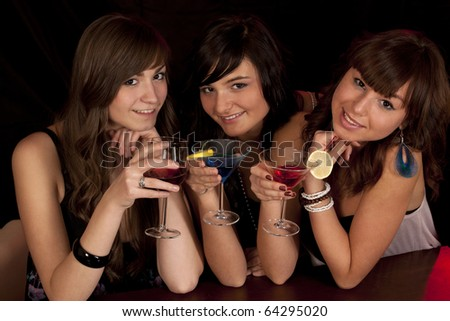 young smiling girls with color cocktail - stock photo