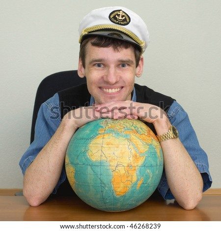 Young smiling guy in the captain's cap - stock photo