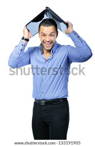Young smiling handsome man with a laptop notebook computer - stock photo
