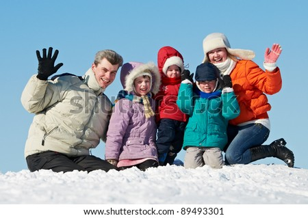 young smiling happy family with three children at winter snow outdoors