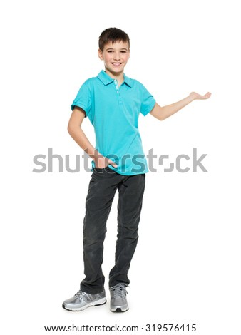 Young smiling happy teen boy  shows  something  isolated on white background.