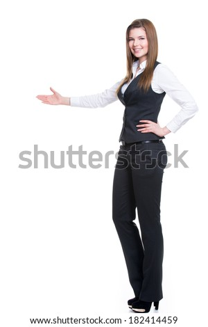 Young smiling happy woman in gray suit pointing at something by hand. isolated on white background. - stock photo
