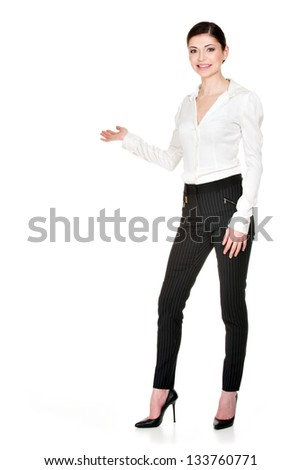 Young smiling happy woman shows  something  isolated on white background. - stock photo