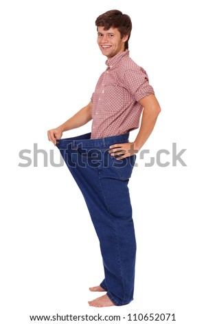 Young smiling healthy happy slim handsome guy in jeans, isolated on white - stock photo