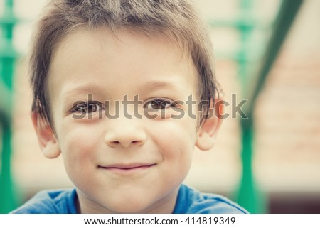 young smiling male child portrait outdoor