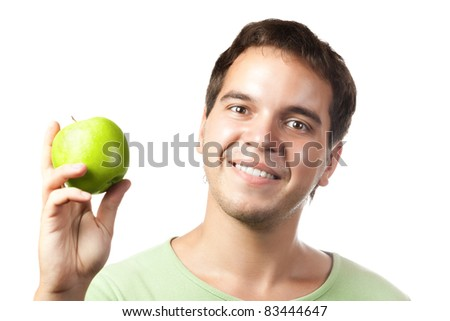 young smiling man holding green apple isolated on white background - stock photo