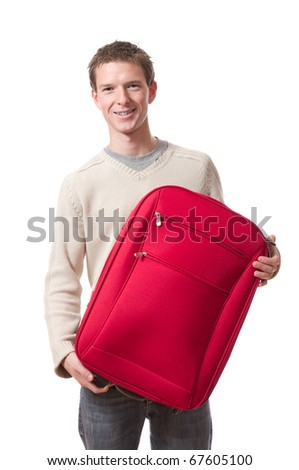 young smiling man holding red suitcase for holidays isolated on white