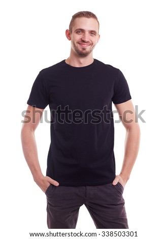 Young smiling man in a black t shirt on white background