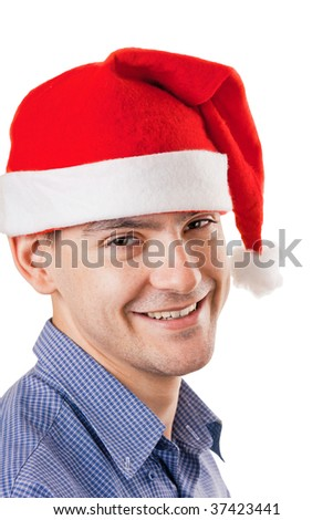 Young smiling man in a Santa hat