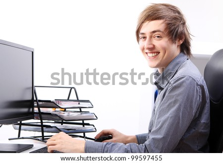Young smiling man in his office - stock photo