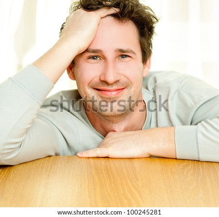young smiling man indoors - stock photo
