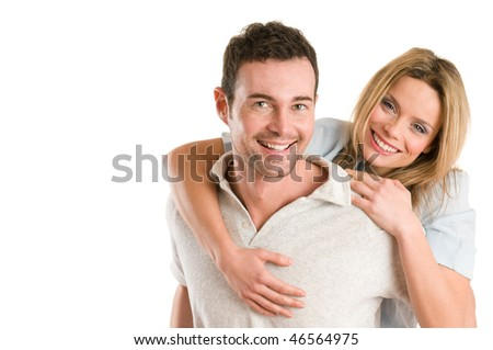 Young smiling man piggyback his beautiful girlfriend isolated on white background with copy space - stock photo