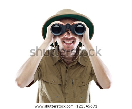 Young smiling man wearing pith helmet looking through binoculars, isolated on white - stock photo