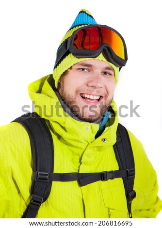 young smiling man wearing winter sports gear on white - stock photo