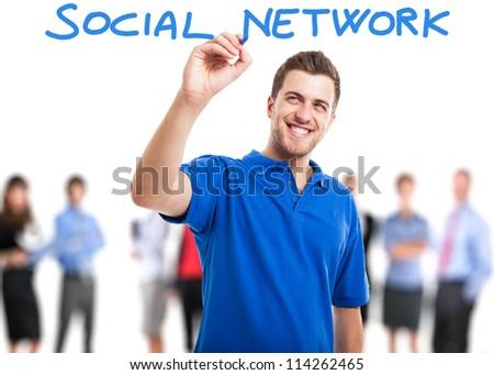 Young smiling man writing social - stock photo