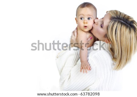 young smiling mother with her baby after bath - stock photo