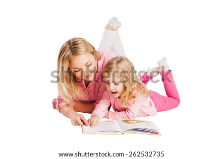Young smiling mother with little daughter studying - stock photo
