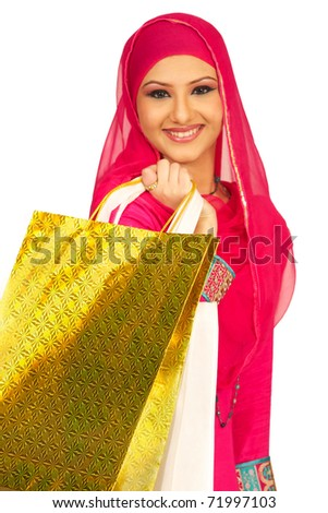 Young smiling Muslim Girl to purchases - stock photo