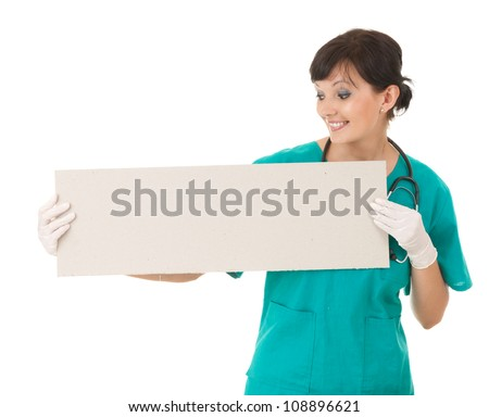 young smiling nurse or doctor showing empty blank sign board, white background - stock photo