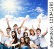 young smiling people  over blue sky - stock photo