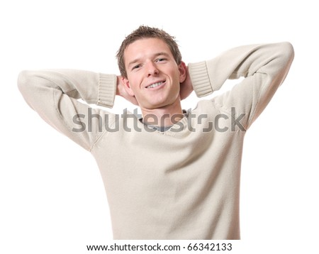 young smiling relaxed man with arms high isolated over white background - stock photo