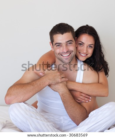 Young Smiling Romantic Couple relaxing in each others Company - stock photo