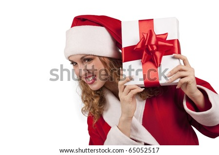 Young smiling Santa emerge from behind a gift box  isolated on white