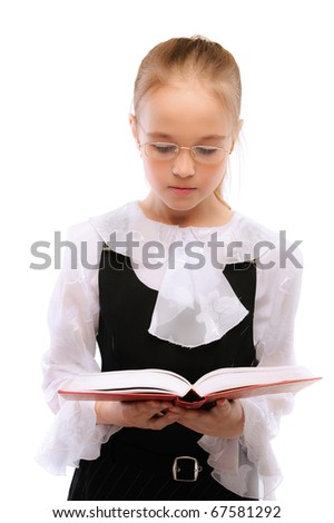 Young smiling schoolgirl read textbook, isolated on white background. - stock photo