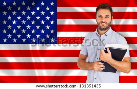 Young smiling student learns the american language - stock photo