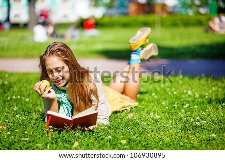 Young smiling student woman with book. University education. - stock photo