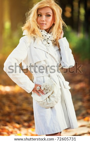 Young smiling woman autumn portrait. - stock photo