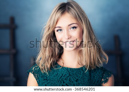 Young Smiling Woman. Beauty Portrait of Young Fashion Model - stock photo