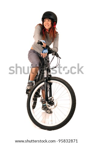 Young smiling woman bicyclist isolated on white, studio shot.
