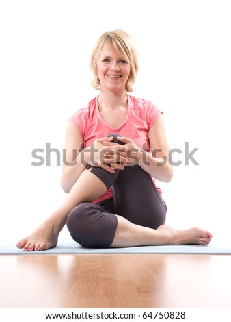 Young smiling woman doing gym with crossed legs