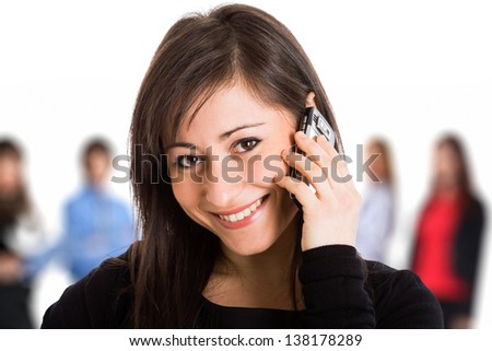Young smiling woman getting in touch with friends - stock photo