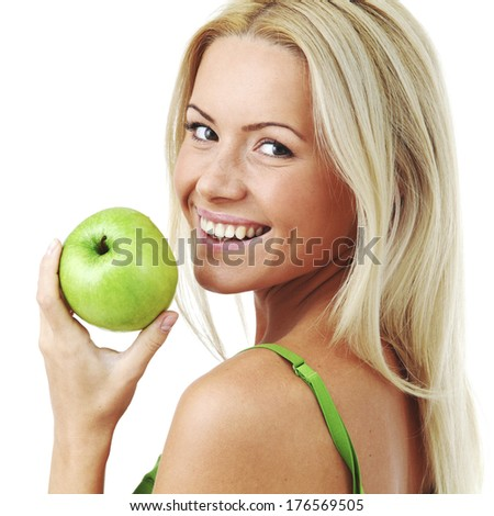 Young smiling woman hold green apple, isolated on white