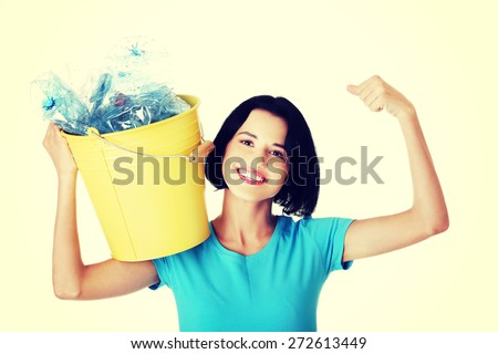 Young smiling woman holding a bucket