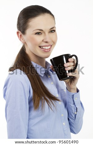Young smiling woman holding a cup of tea