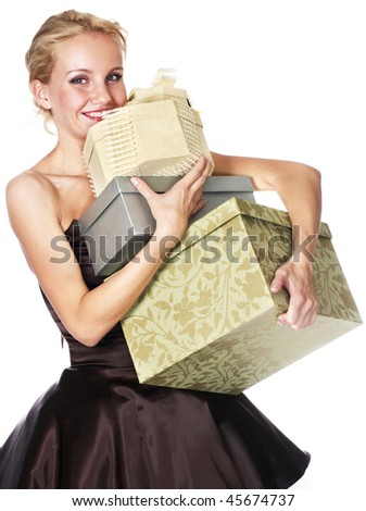 young smiling woman holding boxes of gift - stock photo